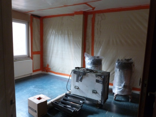 Our old bedroom covered in plastic